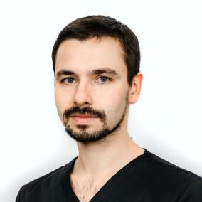 Науменко Георгий Владимирович, стоматолог-хирург