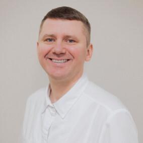 Стрекаловский Евгений Витальевич, стоматолог-хирург