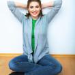 женщина выполняет упражнения для укрепления мышц тазового дна