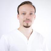 Крахмалов Юрий Юрьевич, стоматолог-хирург
