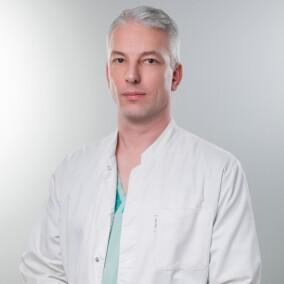 Латынин Александр Всеволодович, стоматолог-хирург